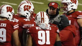 Wisconsin head coach Paul Chryst talks to his players