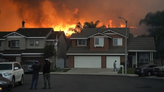 Residents in Chino Hills, California watch anxiously Tuesday as Blue Ridges fire burns near homes.