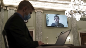 Twitter CEO Jack Dorsey appears on a screen during a Senate Commerce Committee hearing