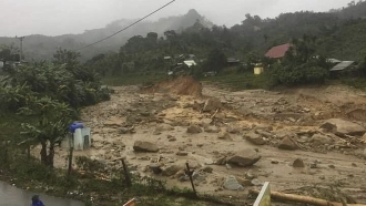 A landslide leaves a trail of rocks and mud as it swamps a village in Phuoc Loc district, Quang Nam province, Vietnam