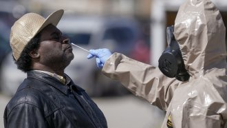 Wisconsin National Guard members administer COVID-19 tests in a parking lot in Milwaukee.