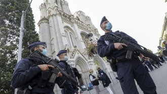 French police officers stand near Notre Dame church in Nice, southern France, Thursday, Oct. 29, 2020.
