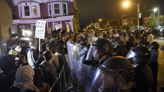 Protesters face off with police during a demonstration Tuesday, Oct. 27, 2020
