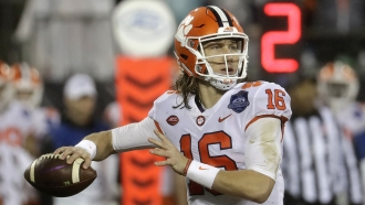 Clemson quarterback Trevor Lawrence looking to pass.