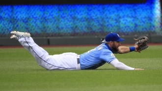 Kansas City Royals left fielder Alex Gordon lays out to catch a fly ball.