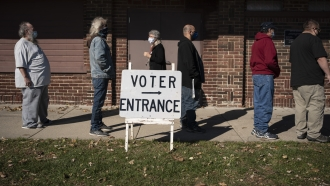 Voters wait outside a polling center on election day in Kenosha, Wisconsin