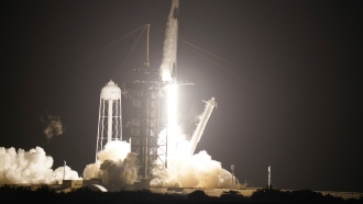 A SpaceX Falcon9 rocket, with the Crew Dragon capsule attached, liftsoff from Kennedy Space Center's Launch Complex.