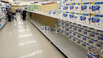 Shelves in the paper towel and toilet paper section are depleted at a Meijer Store in Carmel, Ind., Tuesday, Nov. 17, 2020.