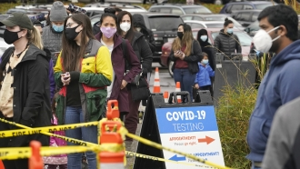 People line up to be tested for the coronavirus at a free testing site Wednesday, Nov. 18, 2020, in Seattle.