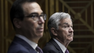 Steven Mnuchin and Jerome Powell sit together in September 2020 Senate hearing