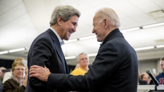 President-elect Joe Biden shakes hands with former Secretary of State John Kerry