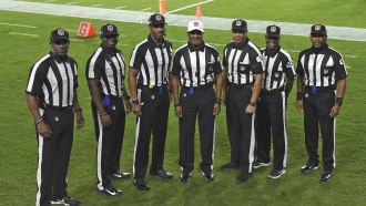 NFL's first all-black officiating crew poses for a photo prior to the game.