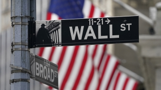 A street sign is displayed at the New York Stock Exchange in New York.