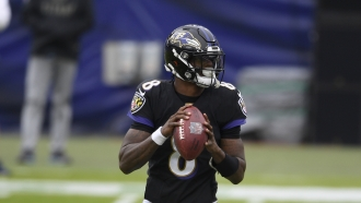 Baltimore Ravens quarterback Lamar Jackson in action during an NFL game against the Tennessee Titans.