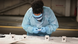 Nurse with COVID-19 test kits
