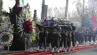 Military personnel carry the coffin of Mohsen Fakhrizadeh, a scientist who was killed on Friday, in a funeral ceremony
