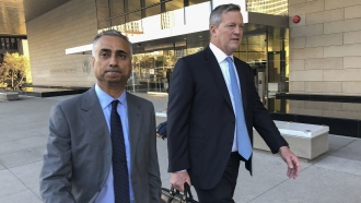 Imaad Zuberi, left, leaves the federal courthouse with his attorney Thomas O'Brien, right, in Los Angeles.