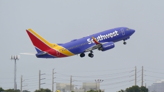 A Southwest Airlines Boeing 737-7H4 takes off.