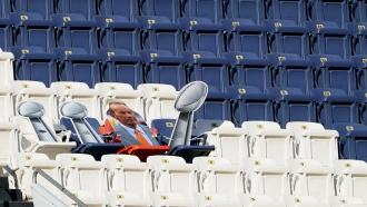 A cut out of the Denver Broncos three Super Bowl trophies