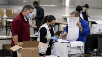 Workers in Fulton County, Georgia, count ballots during the presidential election recount