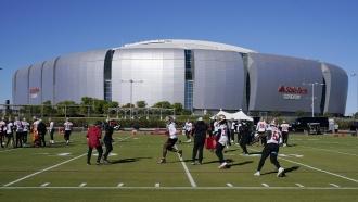 The San Francisco 49ers NFL football team defensive unit runs drills outside State Farm Stadium in Glendale, Arizona