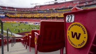 Seats at Fedex Field display the Washington Football Team logo
