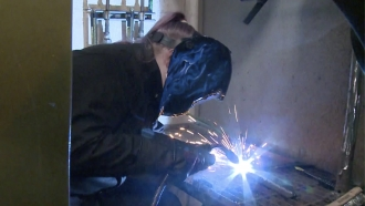Woman learns how to weld