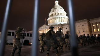 Members of the National Guard arrive to secure the area outside the U.S. Capitol, Wednesday, Jan. 6, 2021, in Washington.