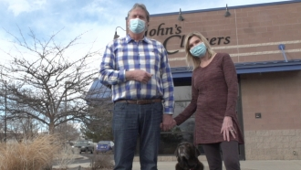 Family stands in front of their business