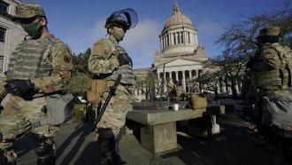 Members of the Washington National Guard stand near the Legislative Building in Olympia, WA.