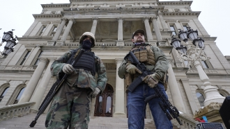 Armed men in front of Michigan State Capitol on Jan. 6
