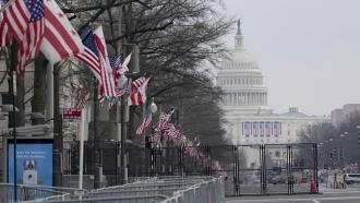 U.S. Capitol behind fence