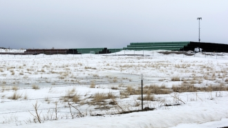 A storage yard for pipe that will be used in construction of the Keystone XL oil pipeline near the U.S.-Canada border.