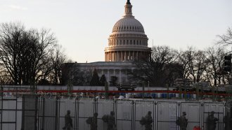 National Guards deploy inside the security perimeter surrounding the Capitol