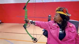 Woman competes in archery