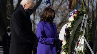 President Joe Biden and Vice President Kamala Harris take part in a wreath laying ceremony at the Tomb of the Unknown Soldier