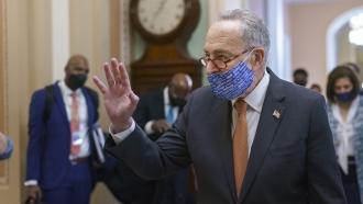 Sen. Majority Leader Chuck Schumer walking through the Capitol