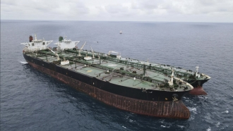 Panamanian-flagged MT Frea, left, and Iranian-flagged MT Horse tankers are anchored in Pontianak waters off Borneo island.