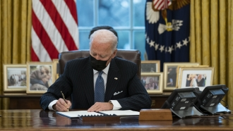 President Joe Biden signs an Executive Order reversing the Trump era ban on transgender individuals serving in military