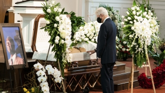 """Former President Bill Clinton pays his respects during funeral services for Henry """"Hank"""" Aaron."""