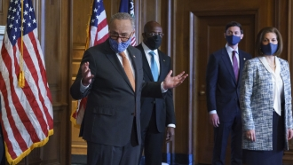 Senate Majority Leader Chuck Schumer and other Senate Democrats