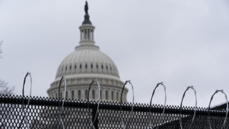 A temporary fence protects the U.S. Capitol.
