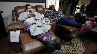 Sherry Brown, left, and her daughter, Taylor, rest in recliners at Gallery Furniture store after the store owner opened up fo
