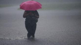 Woman walks through flooded water in Philadelphia