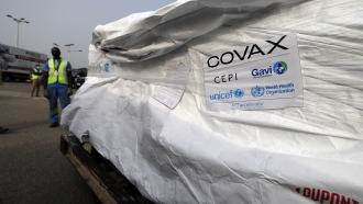 The first shipment of COVID-19 vaccines distributed by the COVAX Facility arriving at the airport in Accra, Ghana