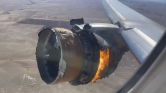 Engine of United Airlines Flight 328 on fire.