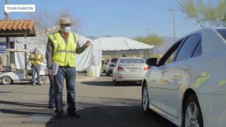 Volunteer works in vaccine site