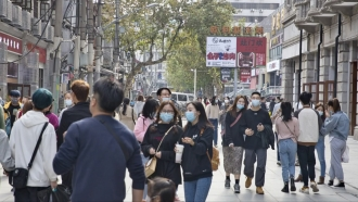 People walk on the streets in Wuhan, China.