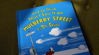"""A copy of the book """"And to Think That I Saw It on Mulberry Street,"""" by Dr. Seuss."""
