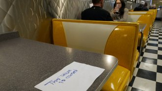 Socially-distanced diners in a California restaurant